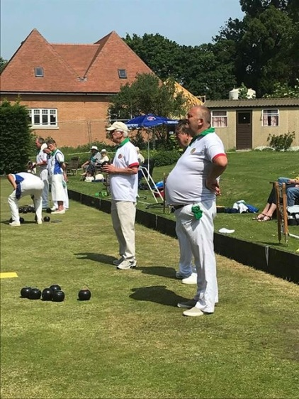 Allen prepares to bowl and Mark watches