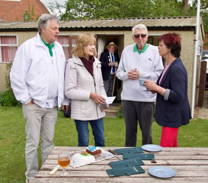 Anne chats to club members Andy, Lorna, and Chairman Brian