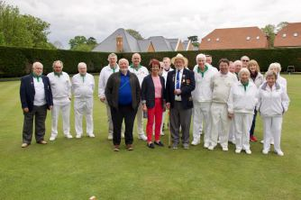 Club members pose with Anne on the green