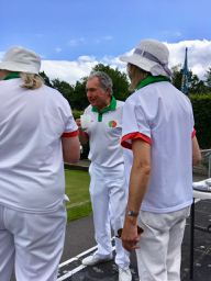Ken has a team talk with Debbie and Lorna