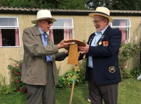 Brian presents the shield to David