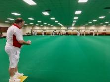 Camberley captain Alan prepares to bowl